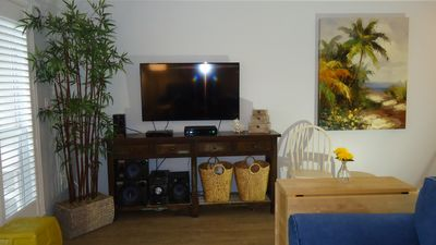 "Living area, 48"" TV, DVD Player, Stereo System, Wifi"