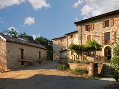 Photo for Giuseppina - converted stone barn with spectacular mountain scenery & pool