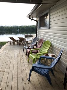 Main Cottage - side deck from kitchen facing fire pit and lake