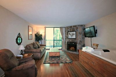Relax in the Jacuzzi Hot Tub in the Open Area Living Room with Gas Fireplace for those Cool Nights