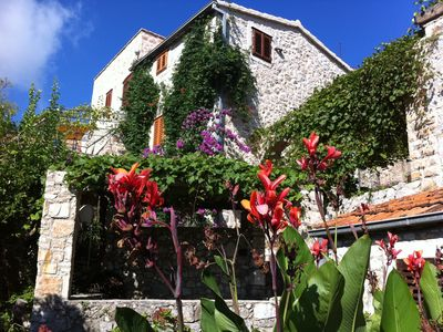Photo for Natural stone house with large garden and sea views in the rustic village of Pitve