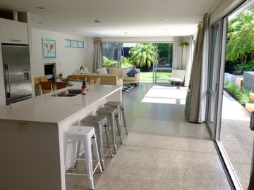 Large, modern and sunny home minutes from beach!