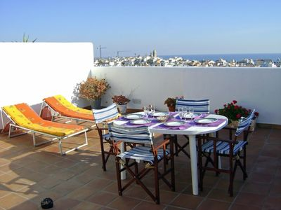 Photo for Fantastic penthouse overlooking the sea, in the center, with 4 bedrooms, swimming pool.