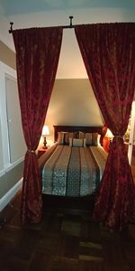 Plush Queen size bed with privacy curtains