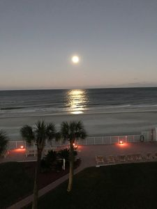 View from balcony of moon over the ocean