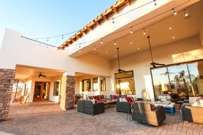 Back patio has a deep & high roof overhang for shade, lounging & entertaining