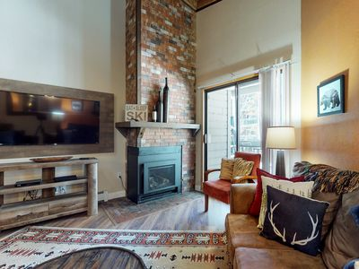 Photo for Lofty condo w/ shared pool/hot tub/game room, private balcony & gas fireplace!