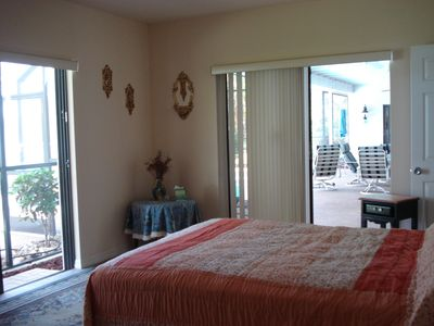 large master bedroom leading to pool  with master bath ...