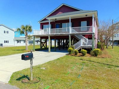 """Photo for """"Seas the Day"""" at Carolina Beach.  Beautiful 3 bedroom house just short walk to the beach with private Hot Tub"""