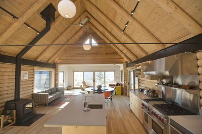 Main open plan A-frame, kitchen, dining, sitting area, wood burning stove