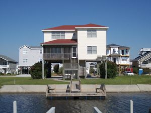Photo for DARE 7, This comfortable canal home boasts a screened-in porch and decks for your enjoyment.