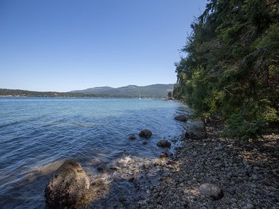 Nestled in a grove of cedars on the edge of Sequim Bay near the Olympic Mountains