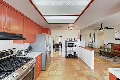 Kitchen - Channel your inner chef in an open kitchen outfitted with a full suite of stainless steel appliances.