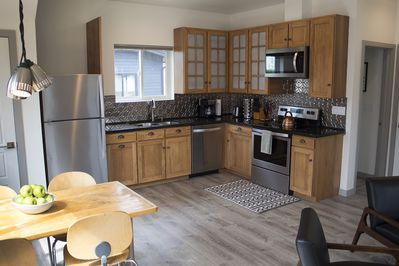 Fully supplied kitchen with stainless steel appliances.
