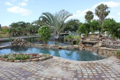 Gorgeous Private Inground pool with views of the intersecting canal and river