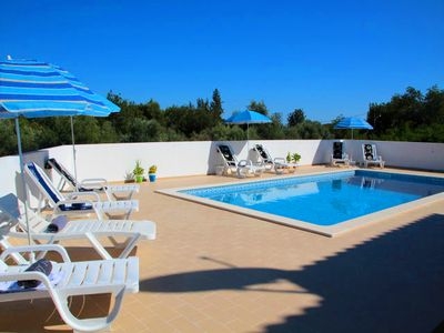 Photo for 4 bedroom Villa, sleeps 12 in Almancil with Pool and WiFi