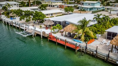 Photo for Southern Comfort! Canal front on 10th w/screened room,2 Kayaks& CABANA CLUB Incl