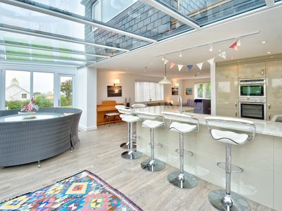 Photo for The real feature of this immaculate bungalow is a magnificent open-plan kitchen, dining and living a