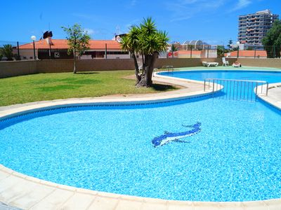 Photo for Homerez last minute deal - Beautiful apt with pool access