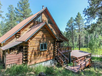 Photo for Secluded, rustic log house on three acres - dog-friendly & close to town!