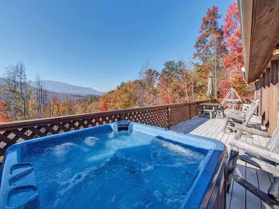 The deck is spectacular - From Alpine Windsong's rear deck you can relish the view of the Great Smoky Mountains while lazing in the hot tub, dining at the picnic table, nestling on the porch swing, or kicking back on a rocker.