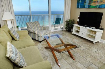Welcome to this bright, airy, well-furnished ocean-view condo! - There's room for everyone to gather in the living room at Majestic 2202 West for games, TV, or to watch the beautiful sunsets! The sofa unfolds into a bed for 2, giving some lucky couple ocean views!