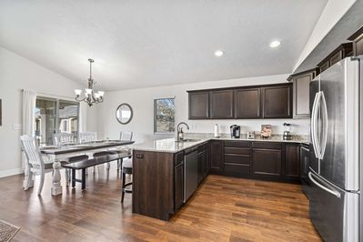 Enjoy home-cooked meals created in this Kitchen that is fully equipped with Fridge, Stove, Oven, Dishwasher, Microwave, Keurig, Blender and Spice Rack