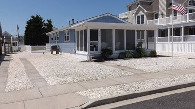 Photo for Cute seashore cottage within walking distance to beach & shopping, screened porch