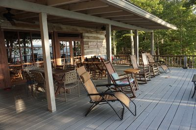 Covered back porch with plenty of seating
