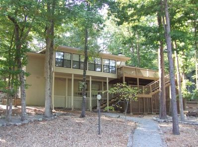 Lakeside view of the property with Arkansas Room and oversized deck.