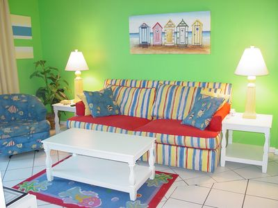 We would be delighted to share our colorful beach condo with you.