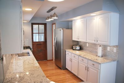 New top end stainless steel appliances and unique stainless backspash