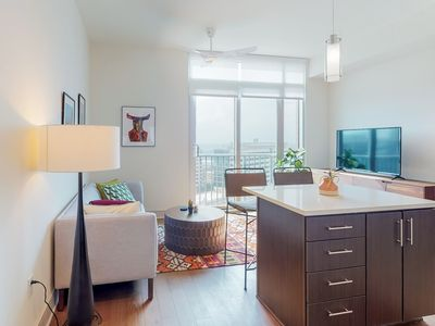 Photo for Stunning apartment in the medical district w/ shared pool, gym, & pool table!
