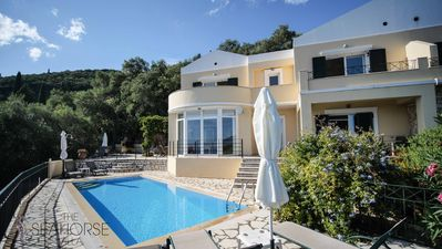Photo for Amazing pool house with a stunning view over Agni Bay