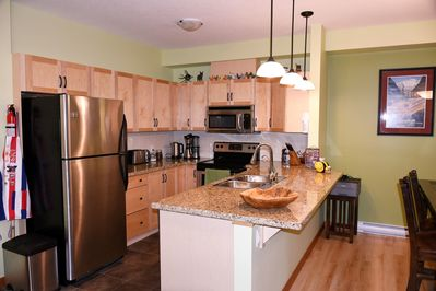 Kitchen.  Well equipped.  Stainless steel fridge, stove, microwave, dishwasher, toaster and coffee maker.  Granite counters.