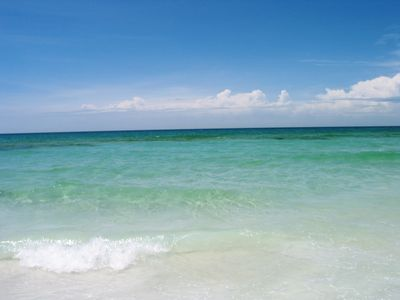 clear emerald green water and sugar white sands sands