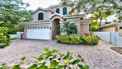 Exterior to Home; 2 Car Garage; Courtyard Home with Privacy Fence; Walk to Vanderbilt Beach; Minutes from Mercato!