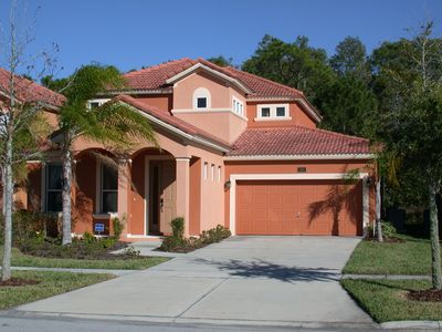 Photo for New Luxury  Disney area 4bed/4 bath villa with pool: Free long distance& WiFi