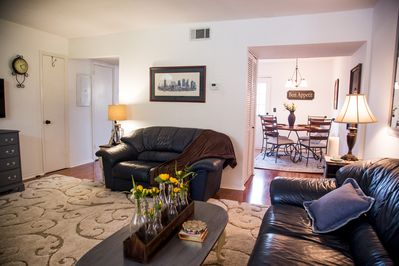 Living room is accessible to kitchen and laundry room