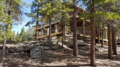 Mountain home with two story wrap-around deck.