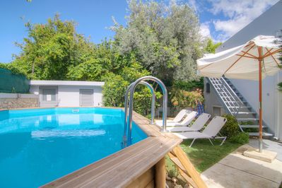 Private swimming pool with sun beds and umbrellas
