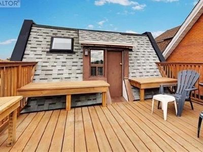 Photo for Rooftop Apartment across from Train Station & Subway Trains
