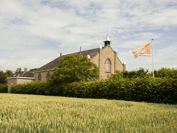 Modern house in an old village church at the Wadden Sea in Frisia