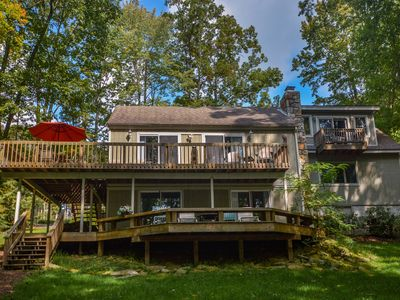 Photo for Lakefront with wrap-around deck!