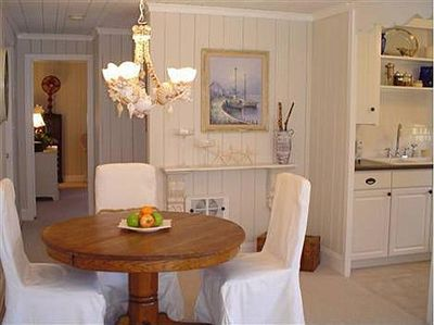 Dining area complete with custom shell chandelier.