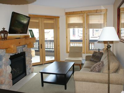 Living Room with queen sofabed, HDTV, gas fireplace overlooking lake