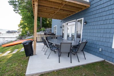 Outdoor seating with outdoor kitchen including grill, 2 burners, sink, fridge