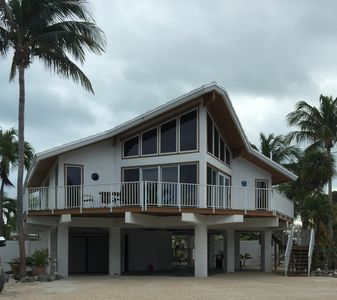Photo for Tiki Chalet Canal front pool home with optional Boat.  Easy Access to ocean