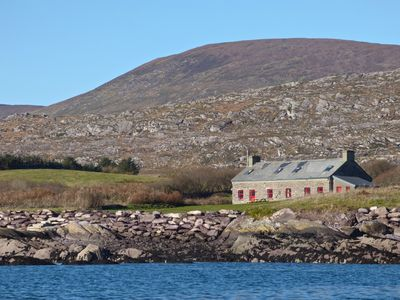Photo for Restored 18C. Coastguard's Cottage on the shore of the beautiful Kenmare Estuary