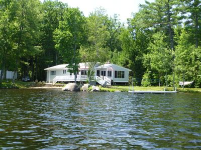 House from the water - private level setting with beach, play area, and dock